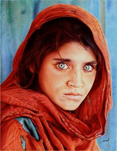 Afghan Girl by Samuel Silva, also known as vianaarts, is a British artist who developed his unique style of ballpoint pen drawing. This incredible work is based on the famous photo by journalist Steve McCurry.