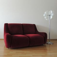 Space age sofa, vintage condition, upholstered in red velvet.