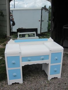 waterfall dresser with a touch of blue