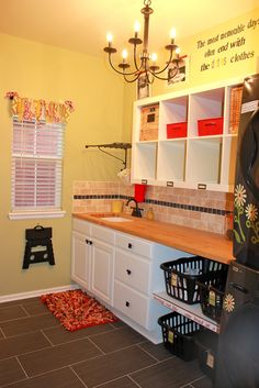 Achieving Creative Order: Laundry Room--Before and After.  Expedit hanging on the wall!!  Love this.