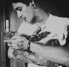 Tattoos piercings and kitten