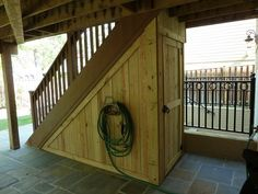 This wood storage shed takes advantage of the space beneath the stairway from the deck in the Arlington, VA home