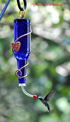 DIY Hummingbird Feeder made w/ Copper Wire and an old Glass Bottle. Found at the GardenRoofCoop