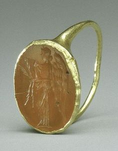 Gold ring with carnelian intaglio: winged Nemesis. Imperial Period. 1st–early 3rd century A.D. Roman, Cypriot. Carnelian, gold. 74.51.4234. The Cesnola Collection, Purchased by subscription, 1874–76. © 2000–2012 The Metropolitan Museum of Art.