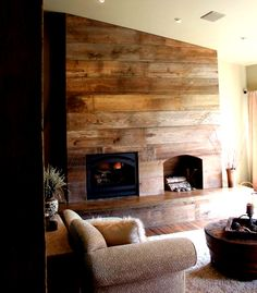 Fireplace made from salvaged barn wood. See www.goodwoodnashville.com for similar projects.