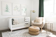 Nurseries are some of our favorite spaces to design in a home. It's a place where mom and dad will be reading bedtime stories,spending late nights up with their newborn and enjoying sweet moments watching their little one grow. Botanical water-color art hung above the crib served as the in