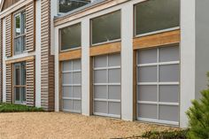 Clopay Avante Collection glass garage doors, clear anodized aluminum frame with etched glass panels. www.clopaydoor.com