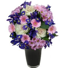 This pretty pink iris and purple gerbera bouquet includes iris, gerberas and brassica. This arrangement is ideal for a birthday or anniversary. £30