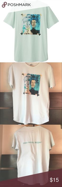 UNIQLO SPRZ Jean-Michel Basquiat Graphic t-shirt Iconic work reinterpreted for UNIQLO line up of graphic tee's. Awesome shirt to makes stamens or just casual. Shirts Tees - Short Sleeve