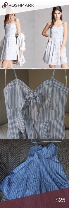 Flared White and Blue Pinstripe Dress The ideal summer dress with white and blue pinstripes and the cutest sweetheart neckline with a tie-able bow. Brand new. Forever 21 Dresses