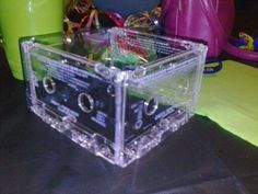 Awesome 80's themed centerpiece! Pull apart a cassette tape and glue them together with a glue gun at the corners in a square and enjoy!!
