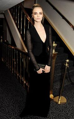Cara Delevingne in a black Burberry dress