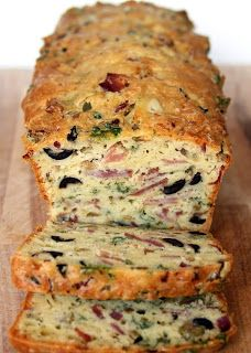 "olive bacon and cheese bread 5 fl oz of white wine 3 1/3 fl oz olive oil 4 eggs 1/2 tsp salt 2 1/2 cup all purpose flour 1 tsp of baking powder 5 oz grated emmenthal or cheddar 1 large onion 3 1/2 oz bacon 7 oz city ham, already cooked — sold as ""ready to serve"". Still on the bone, it's better! If you don't want to bring back the whole ham at home, ask your butcher to slice it off for you. 3 1/2 oz black olives 3 1/2 oz green olives 2 TBSP chopped parsley"