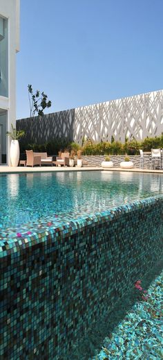 Laser cut metal along pool wall very effective