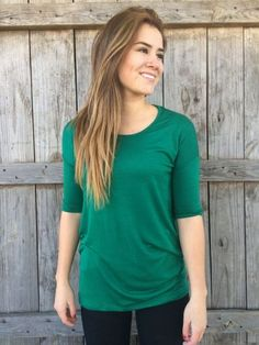 I love this color! I also love how comfy and cute this tunic looks with leggings.