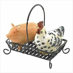 """Barnyard Salt and Pepper Set - Style 39163 by Gift Warehouse. $18.95. 6 1/2"""" x 4 1/4"""" x 6 1/8"""" high. No farmhouse table or country kitchen is quite complete without this perky pair of pals. Two countryside cuties snuggle together in their cozy basket, holding a generous supply of salt and pepper right within easy reach. Dolomite with metal holder. Hand wash. Two countryside cuties snuggle together in their cozy basket, holding a generous supply of salt and pepper r..."""