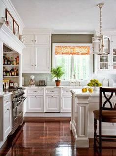 Dark floors, white cabinets, grey walls and peach fabrics. Stunning. #revitalizeandredesign