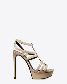 Saint Laurent sandal with triple straps at forefoot and ankle, beveled platform and extended footbed.