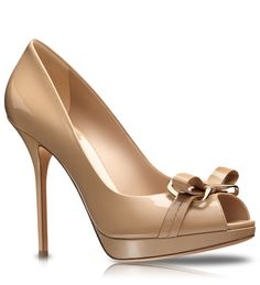 Beige glazed leather pumps by Dior