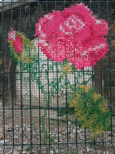 Amazing street art on chicken wire and railings fence of a beautiful rose crochet lace worl or just weaving a very sophisticated form of yarn bombing or a romantic cross stitch style paint job Yarn Bombing, Graffiti, Cross Stitching, Cross Stitch Embroidery, Guerilla Knitting, Street Art, Urbane Kunst, Fence Art, Land Art