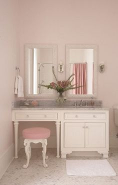 pretty bathroom with a mauve velvet french vanity stool tucked