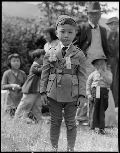May 9, 1942 —Centerville, California. This youngster is awaiting evacuation bus. Evacuees of Japanese ancestry will be housed in War Relocation Authority centers for the duration.