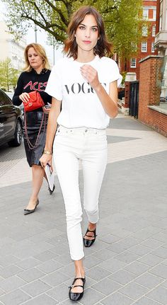 Alexa Chung stuns in this rocker-inspired all-white outfit and ladylike black flats