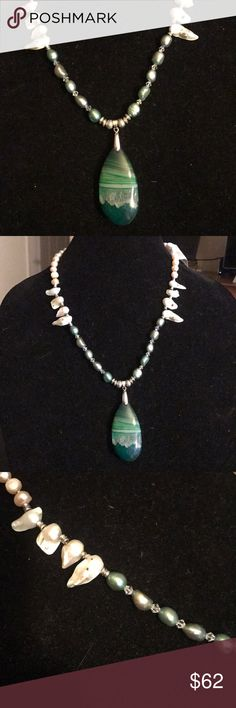 "beautiful freshwater pearl necklace Beautiful freshwater pearl and Swarovski crystal necklace with a green agate pendant. Necklace measures 21"". Necklace is handcrafted and one of a kind. Was designed and crafted in my home studio. I believe each piece of jewelry be as unique as the woman wearing it. Authentic freshwater pearls and gemstones. Will arrive in an organza pouch. Each jewelry purchase comes with free earrings. Please check out my closet for more one of a kind jewelry. Bundle two…"
