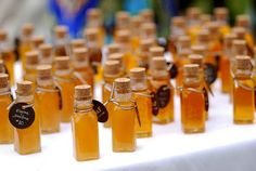 Mini bottles of honey as a gift for guests as well as let them know where to sit!
