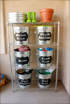 Love this idea for keeping kids stuff organized inside or out. A silhouette machine was used to cut black vinyl labels for each bucket. The galvanized buckets and shelf were purchased at Home Depot.