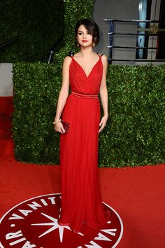 Selena sets the red carpet on fire with her stunning red dress. via StyleList | http://aol.it/1vaG1vh