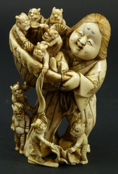 """19th C JAPANESE IVORY GROUP FIGURE WOMAN w ONI Antique fully reticulated Japanese ivory group figure depicting a woman holding a basket full of Oni demons. High attention to detail. 19th century. Measures 3 3/4"""" height x 2 1/2 width"""