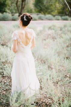 Sarah Janks soft and feminine wedding dress  || See more wedding gowns at Denver Bridal Shop, Emma & Grace Bridal Studio || https://emmaandgracebridal.com || #sarahjanks