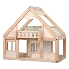 Our My First Dollhouse by Plan Toys features simple design that encourages imagination. A balcony, sliding doors, and four rooms complemented by sturdy manufacturing make this house perfect for small