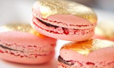 Gilded Macarons at Dominique Ansel. Pink champagne shells with chocolate champagne ganache. 24k, of course.
