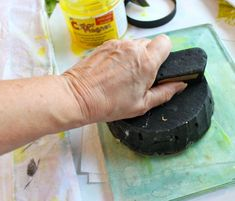 Pushing wood printing block into plate - using your Gelli Plate as a stamp pad!  :D