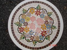 floral mosaic. Possible ides for table on the back porch.