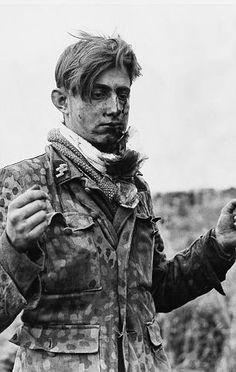 Hard fought: A wounded eighteen-year-old German sniper taken prisoner in the Caen-Tilly se...