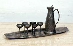 Friedrich Adler Art Nouveau Pewter Liqueur Set: http://www.antiquestovintage.com/ads/friedrich-adler-art-nouveau-pewter-liqueur-set/