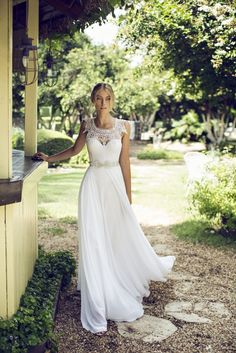 The detail on this dress is stunning! And is the perfect pick for a rustic themed wedding. Simple and creative.