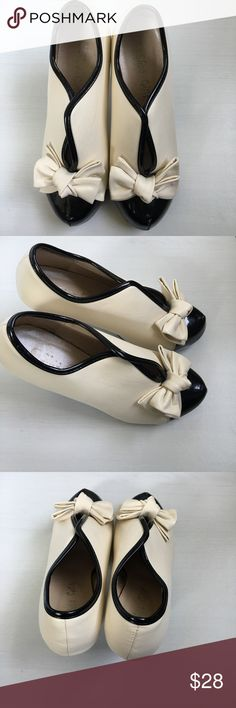 Cream + Black Bow Heels Adorable cream and black bow heels. Patent leather toe and trim. Only worn twice. Some small scuffs as pictured. UK size 37, which is comparable to US size 6.5 but please check online conversion size charts to see if these will work for you! They were true to size when I was a 6.5. *Not ModCloth, brand is Shoe Girls and I can't remember where I purchased 🙈* Modcloth Shoes Ankle Boots & Booties