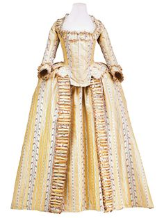 Robe à l'Anglaise, France, c. 1780. Yellow and cream striped silk taffeta embroidered with small floral festoons.