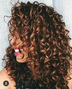 10 Tricks Every Girl with Curls Needs to Know About Her Hair