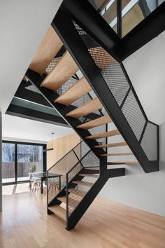 Modern Montreal Duplex Showcases Industrial Minimalism at its Functional Best Home Stairs Design, Railing Design, Stair Design, Steel Stairs Design, Staircase Design Modern, Wood Stairs, House Stairs, Painted Stairs, Architecture Design