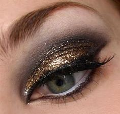 Glamour Eyes - smokey eyelids with a splash of gold glitter, winged eyeliner, white liner for the lower waterline: