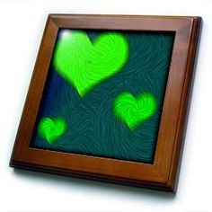 """3 of Green Hearts - 8x8 Framed Tile by Yves Creations. $22.99. Cherry Finish. Inset high gloss 6"""" x 6"""" ceramic tile.. Dimensions: 8"""" H x 8"""" W x 1/2"""" D. Keyhole in the back of frame allows for easy hanging.. Solid wood frame. 3 of Green Hearts Framed Tile is 8"""" x 8"""" with a 6"""" x 6"""" high gloss inset ceramic tile, surrounded by a solid wood frame with predrilled keyhole for easy wall mounting.. Save 15%!"""
