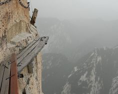 Huashan in China. You hook yourself up to a harness (or not) and walk along this path that hugs the side of a very high mountain.