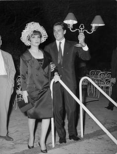 Jauntily helping Gina Lollobrigida – who is looking a little worse for wear – find a lost bracelet. (Yes, really.)
