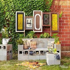 If you can't stop thinking about spring, start thinking about a porch makeover! Outfit your space with scintillating signage and creatively constructed furniture. This front yard patio posts the home's house numbers in an easy-to-read manner. Concrete blocks stack up as end tables and sofa. Note how purposefully positioned blocks provide storage caches for collections, reading materials, and extra picnic gear. #BHGHome