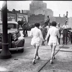 Two women, who wear shorts in public for the first time, draw male attention and cause a car accident! Toronto, 1937.